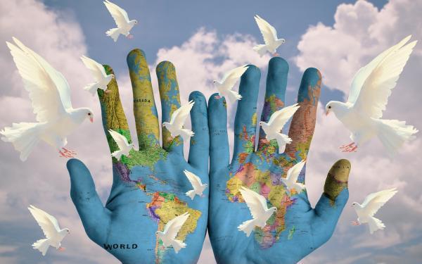wereld in handen en duiven